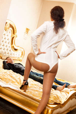 Young couple in a bedroom. Camera angle view. photo