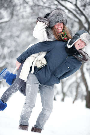 Young couple outdoors fun. Winter season. photo