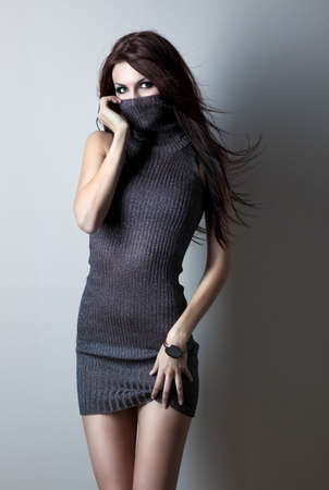 Young slim woman on wall background. photo