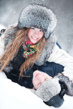 Young couple outdoors fun. Winter portrait. Stock Photo - 6243706