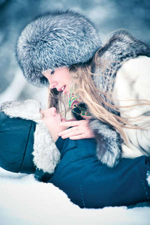 Young couple outdoors winter portrait. Soft blue tint. Stock Photo - 6243693