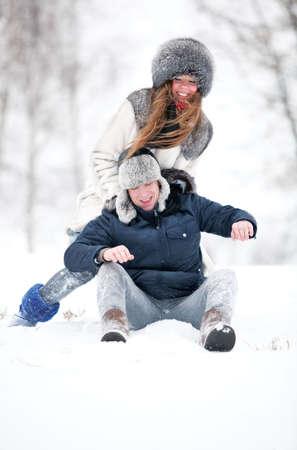 snow girl: Young couple outdoors fun. Winter season. Stock Photo