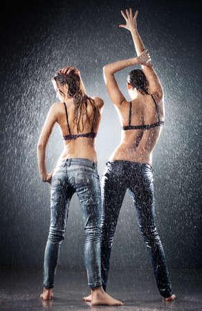 Young sexy women. Water studio photo. photo