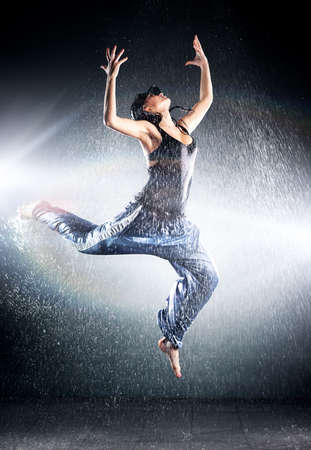 Young woman modern dance. Water studio photo.