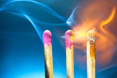 sulphur: Three burning matches macro. Stock Photo
