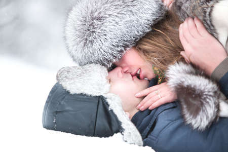 Young couple kissing. Outdoors winter portrait. photo