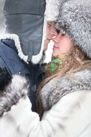 couple winter: Young couple embracing. Outdoors winter portrait.