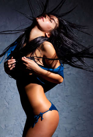 Young dancing woman. Contrast shadows effect. Stock Photo