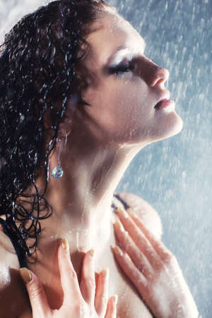 Young sexy woman portrait. Water studio photo. photo