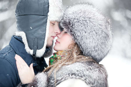 kisses: Young couple tender outdoors portrait.