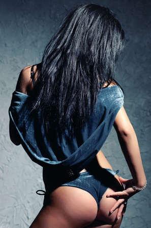 Young sexy woman. Backside view. photo