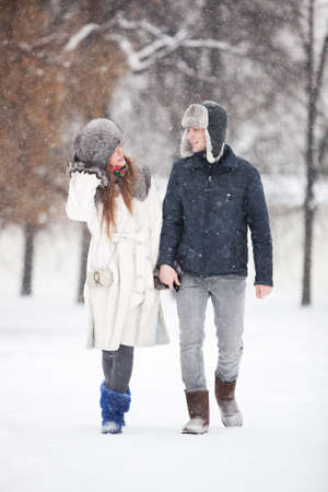 walking paths: Young couple walking in a park. Winter season.