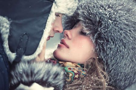 Young kissing couple outdoors portrait.