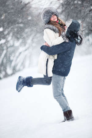 Young couple in a park. Winter season. photo