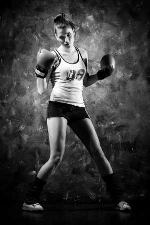 combat sport: Boxer woman. Contrast black and white colors. Stock Photo