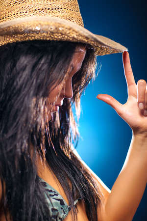Young sexy woman in cowboy hat portrait. Shallow dof. photo