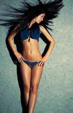 Young sexy brunette woman dancer with fluttering hair. Stock Photo - 6596780