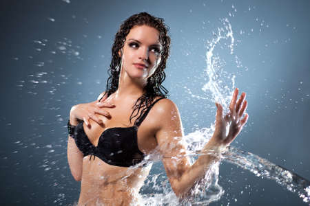 Water flowing on woman hand. Water studio photo