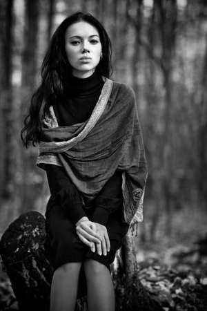 Young woman in forest. Black and white concept. photo