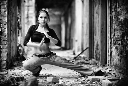 Young woman in a ruined building. Black and white contrast colors. photo