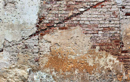 Old damaged brick wall texture. photo