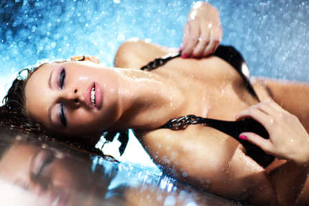 sensuality: Young woman passion. Water studio photo.