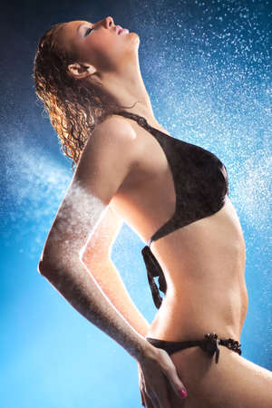 Young sexy woman water studio photo. Focus on face. Stock Photo - 6809032