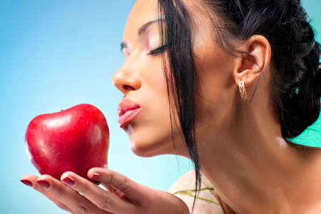 Young woman with apple. Rich bright colors. Stock Photo - 6837081
