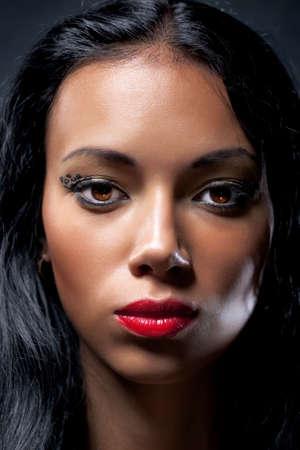 swarthy: Young brunette woman portrait. Dark contrast colors.