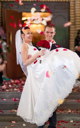 Young wedding couple. Traditional coming out after marriage registration. Stock Photo - 6903112