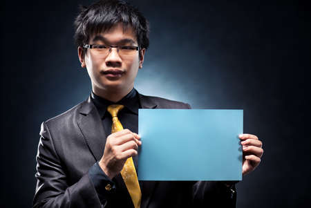 Young japan businessman with blank page. Contrast colors. Stock Photo - 6903162