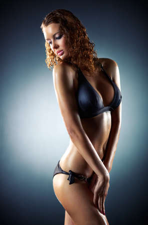 nude woman sexy: Young sexy woman. On dark background. Stock Photo