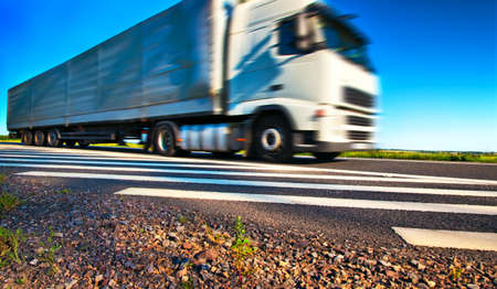 land transport: Truck transportation. Wide angle view and blurred motion effect.