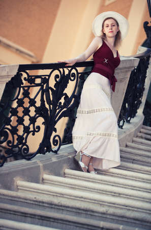 angle view: Young slim woman on stairs. Camera angle view. Stock Photo