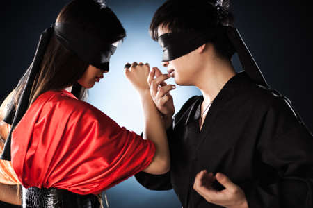 Young japanese couple fighting. Focus on hand and faces. photo