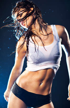 nude wet: Young sexy dancing woman. With drops of water. Stock Photo