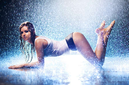 Young sexy woman. Water studio. Stock Photo