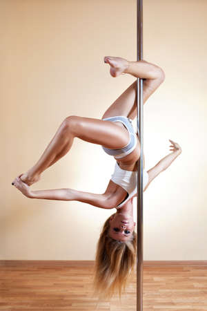 Young sexy pole dance woman. photo