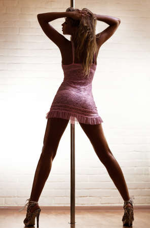 Young sexy pole dance woman. Stock Photo - 7517234