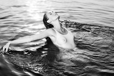 river water: Young woman swimming. Black and white colors.