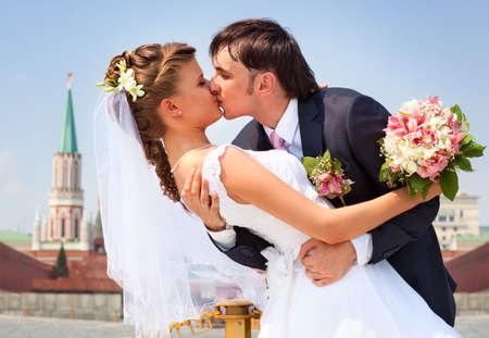 Young wedding couple kissing. Romantic portrait. photo