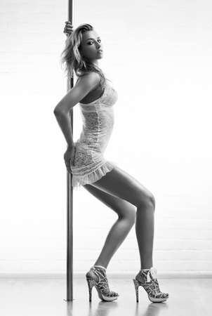 Young sexy pole dance woman. Black and white. photo