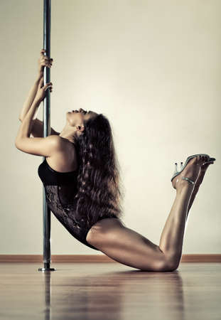 Young sexy pole dance woman. Stock Photo - 7777757