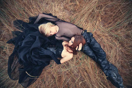 gothic girl: Young goth couple outdoors. Camera top view. Stock Photo