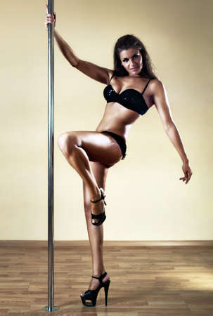 Young sexy pole dance woman. Contrast colors. Stock Photo - 7777745