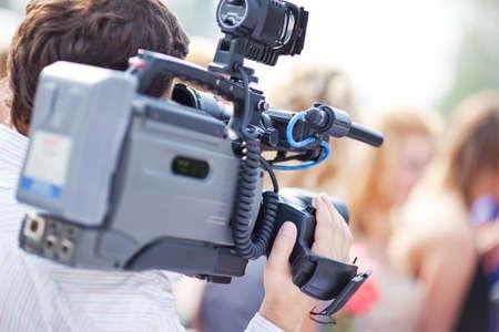 Cameraman at work. Shallow dof effect. Stock Photo