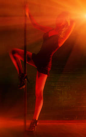 Young sexy pole dance woman. Inverted colors effect. Stock Photo - 7878192