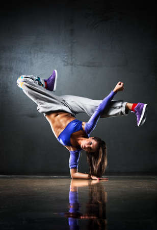 Young woman dancer. On wall background. Stock Photo - 7967857
