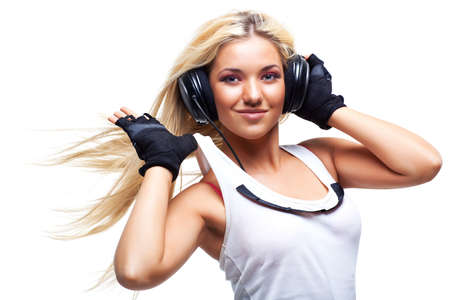 headphone: Young woman with big headphones. Isolated on white. Stock Photo