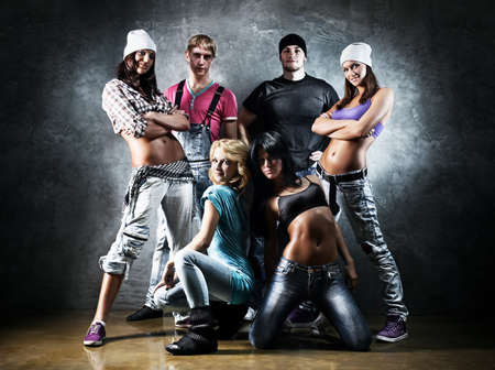 hip hop dancing: Dancer team. Contrast colors effect.